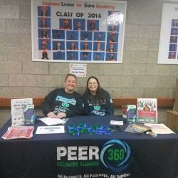 Peer 360 sets up a table at the 5th Annual Warm a Child for Winter Event