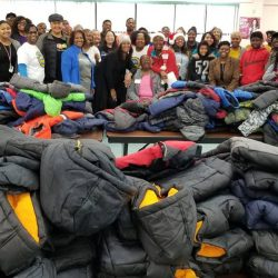 Volunteers are pictured with coats the 5th Annual Warm a Child for Winter Event